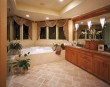 Tiled Floor in Bathroom with Tub by Windows